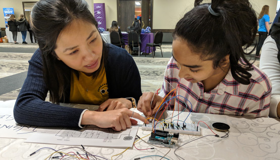 A student learns how to read wiring diagrams at Build a Dream.