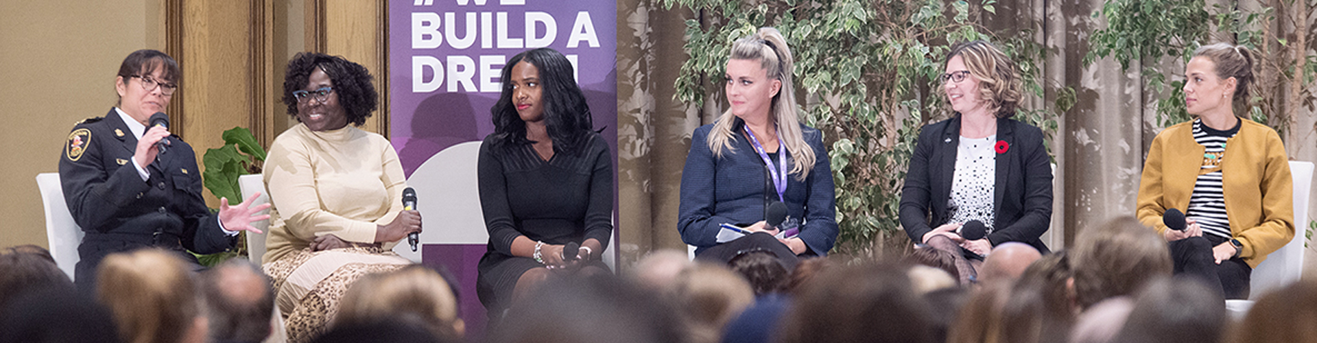 A panel of speakers and women in trades chat at Build a Dream's career discovery expo.