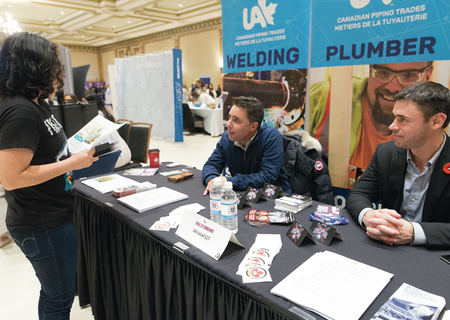 UA recruiters talk to a student at a Build a Dream career discovery expo in Ontario.