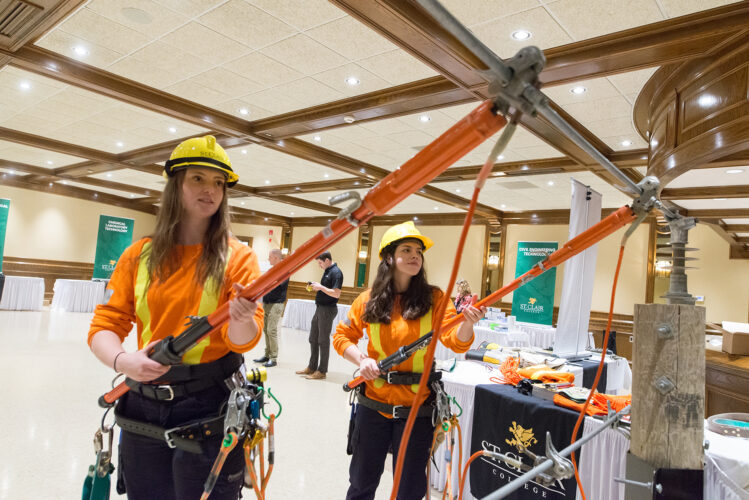 Powerline Tech reps from St. Clair College demonstrate some of their powerline training at a Build a Dream career discovery expo in Windsor, Ontario.