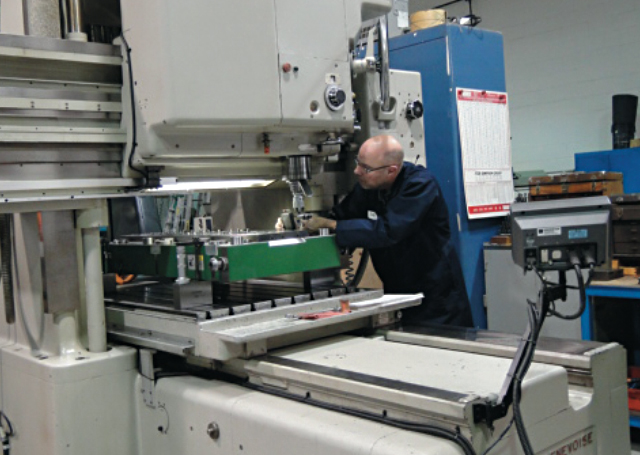 Robert Cattle, Executive Director, CTMA, works on a machine at MicroMetric